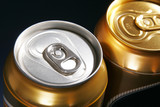 silver and gold aluminum drink can poster