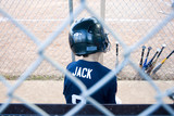 boy in baseball dugout