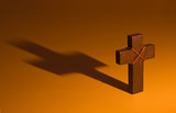 Moody wooden cross casting long shadow poster