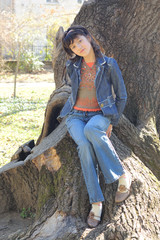 Beautiful girl in park relaxing