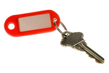 Key with key tag isolated on white background