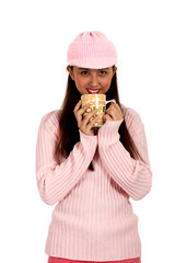 teenager sipping a hot coffee