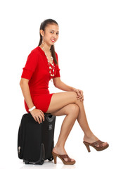 girl sitting on a luggage