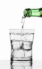 pouring water from a bottle-clipping path