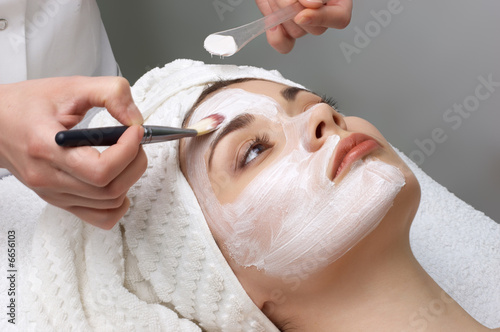 Leinwandbild Motiv beauty salon series, facial mask applying