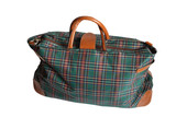 Isolated chequered travelling bag on white background