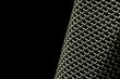 macro of microphone mesh on black