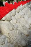 Buddhist statues in Takaosan, Japan poster