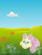 easter Bunny and eggs among flowers on the grass