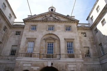 portico. coat of arms. balustrade. windows. facade. exterior