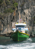 Motor boat at the shore of Phi-Phi island, Thailand poster
