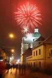 Celebratory fireworks behind a Catholic church poster