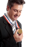 Businessman of the Year - Proud man admires his medal poster