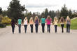 Ten girls walking hand in hand