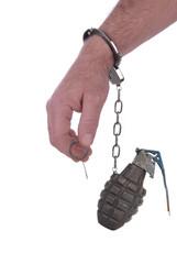 Handcuffed to a grenade
