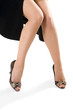 sexy woman legs in black shoes isolated on white background
