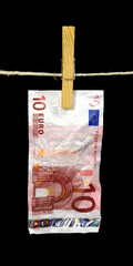 a ten euro note hanging from a clotheline