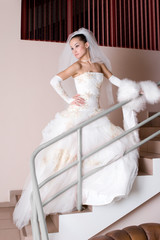 serious bride on the staircase