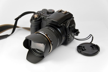 modern profesionalny camera SLR on the white background