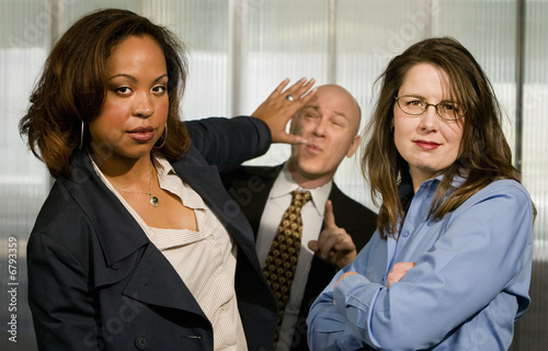 Businesswomen Push back a Businessman