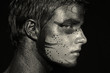 Portrait of young boy with artistic bodypaint drawing on face