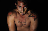 latin young male with intense look and bodypaint drawing poster