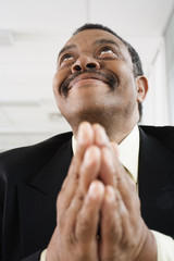 Close up of a man praying.