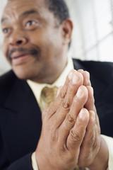 Close up of a man praying.