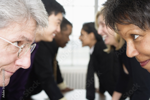 Close up of executives looking at each other.