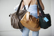 Rear view of a woman carrying bags.
