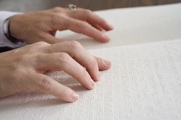 Close up of fingers on Braille.