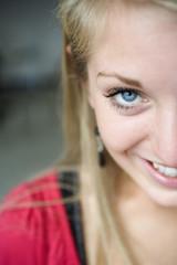 Portrait of a woman smiling.