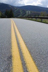 Close up of yellow divider lines on a highway.
