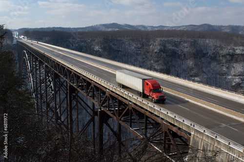 Leinwandbild Motiv Trucker on New River Gorge Bridge