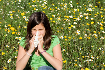 child with hayfever allergy sneezing blowing nose