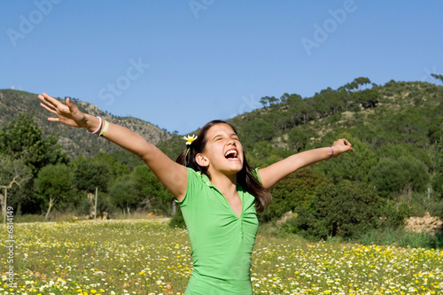 Photo: happy child singing shouting with joy and happiness © godfer #