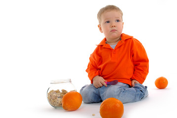Five-year happy old boy with orange fruit