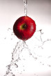 water pouring over red apple