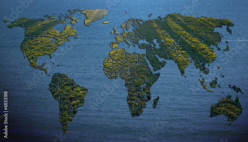 World map filled with grass on background of water