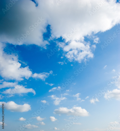 poster of cloudscape of fluffy clouds in the blue sky