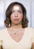 Businesswoman with a blank note on her forehead poster