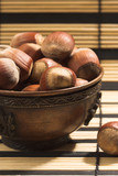 Hazelnuts in a cup poster