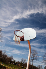 basketball hoop on a red court at a park