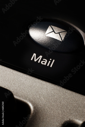 Email button on a computer keyboard for communication.