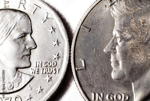 Two dollar coins facing each other.