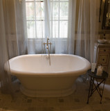 Classic bathtub with chrome plumbing and tile floor. poster