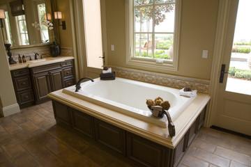 Spacious bathroom with a modern tub and tile floor.