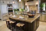 Fototapety Luxury home kitchen with a granite island.