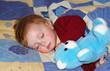 Beautiful girl sleeps with her bear