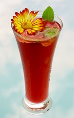Red strawberry drink–cocktail with mint and flower